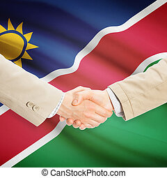 Businessmen handshake with flag on background - Namibia -...