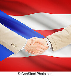 Businessmen handshake with flag on background - Puerto Rico...