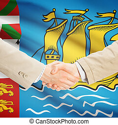 Businessmen handshake with flag on background - Saint-Pierre...