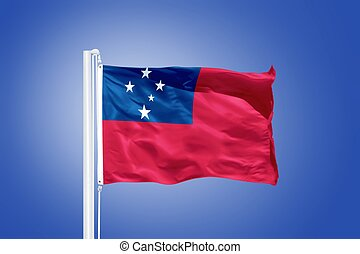 Flag of Samoa flying against a blue sky