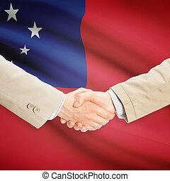 Uomini affari, stretta mano, con, bandiera, su, fondo, -,...