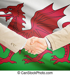 Businessmen handshake with flag on background - Wales -...