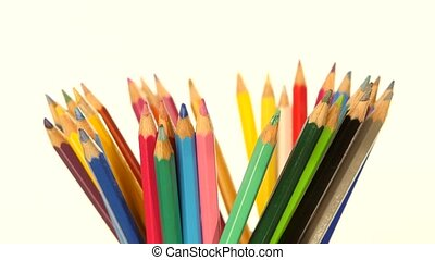 Colour pencils isolated on white, rotation - Many colour...