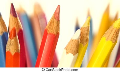 Colour pencils isolated on white, rotation, close up - Many...
