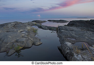 Lake Ladoga, Karelia - summer Sunset on lake Ladoga in North...