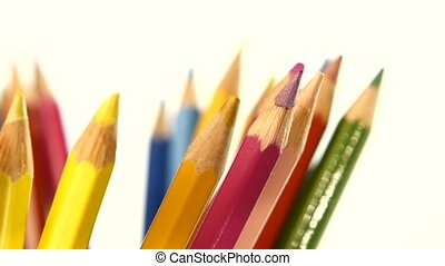 One side of colour pencils isolated on white, rotation, close up
