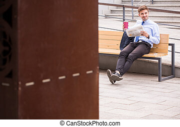 Passenger drinking coffee on station - Image of male...
