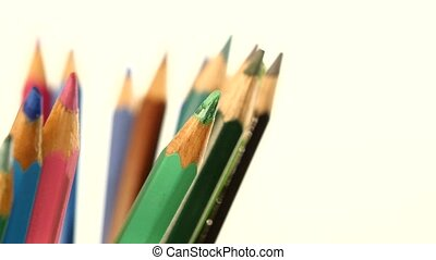 Side of colour pencils isolated on white, rotation, close up...