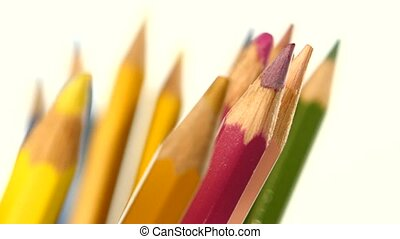 Different colour pencils isolated on white, rotation, close...