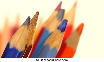 Top of different colour pencils isolated on white, rotation, close up