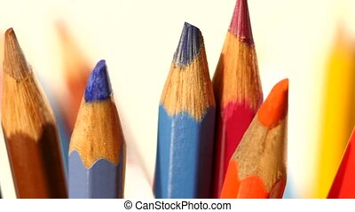 Top of different colour pencils on white, rotation, close up