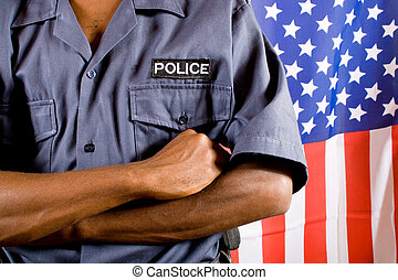 policeman - african police officer, background is american...