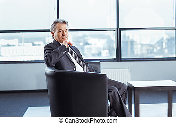 Confident businessman in office.