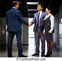 business men shaking hands - cheerful business men shaking...