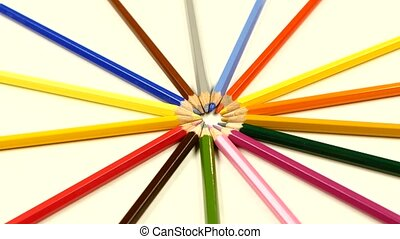 Bunch of colored pencils on white, rotation - Bunch of...