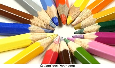 Bunch of colored pencils on white, rotation, close up -...