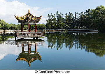 ancient chinese pavilion in park - ancient chinese style...