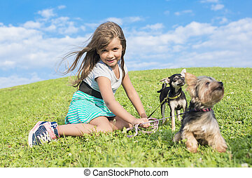 portrait of girl keeping pretty dog outdoor - A portrait of...