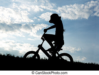 Silhouette of a young child on backlit