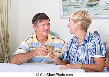 celebrating couple - a celebrating senior couple toasting...