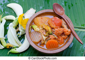 hot and sour curry with tamarind sauce, fish and vegetables...