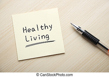Healthy Living - Text Healthy Living written on the sticky...