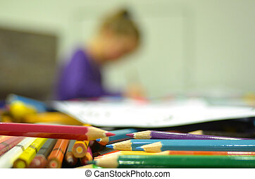 Girl drawing with color pencils - Selective focus of colour...