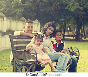 indian family enjoying quality time at outdoor park