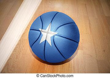 basketball ball with the national flag of somalia lying on...