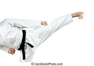 In karategi man doing kick yoko-geri