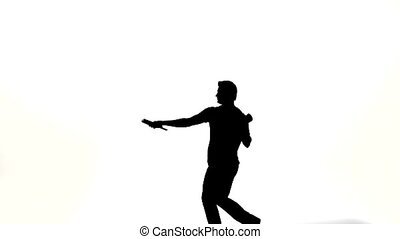 silhouette of barman showing tricks with a bottle on white...