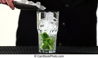 bartender preparing mojito cocktail drink, slow motion