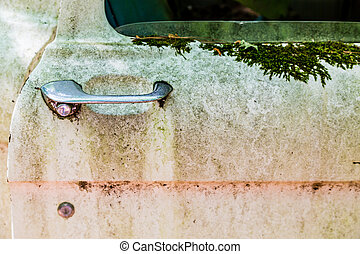 Old Truck Door Handle - Old door handle on a rusty abandoned...