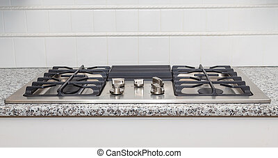Stainless Steel Cooktop on Granite Countertop - New...
