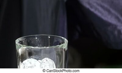 Ice cube isolated on white close up slow motion - Barman...