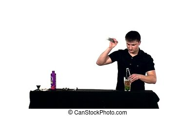 bartender preparing coctail with bar equipment, slow motion...