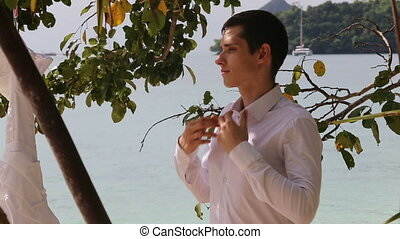 groom in black trousers buttons collar up - handsome groom...