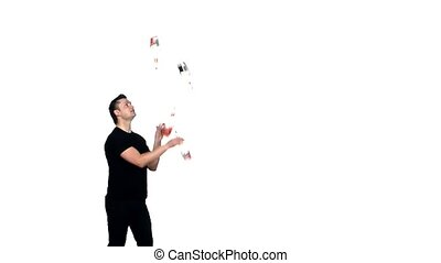 barman showing tricks with a bottle - silhouette of barman...