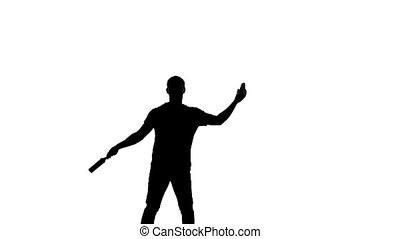 silhouette of barman man showing tricks slow motion -...