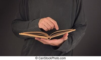 Man reading vintage book - Man reading old vintage book with...