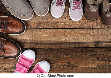 Various colourful footwear on the wooden background