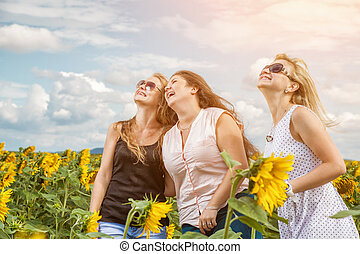 Three friends having a good time outdoors