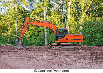 crawler excavator - Orange crawler excavator standing in the...