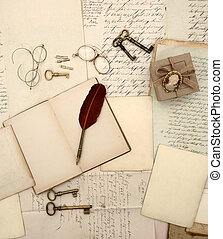 Vintage accessories, open book, old letters and documents...