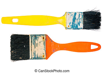 Two old used paint brushes isolated on white background