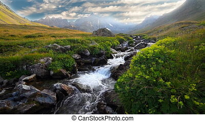 River in mountain valley at the foot of Mt Kakar, eastern...