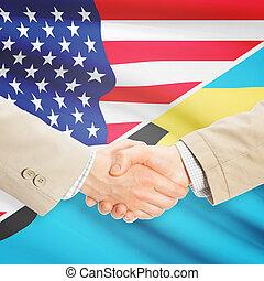 Businessmen handshake - United States and Bahamas -...