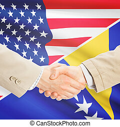 Businessmen handshake - United States and Bosnia and...