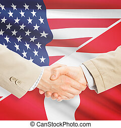 Businessmen handshake - United States and Denmark -...