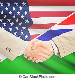 Businessmen handshake - United States and Gambia -...